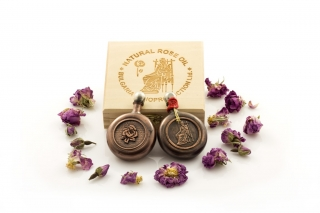Rose oil in a copper container and placed in a luxurious wooden box  132g