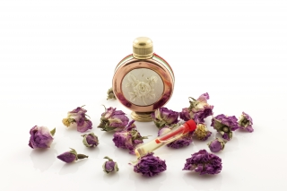 Rose oil in a beautiful vial and placed in luxurious wooden box 150g